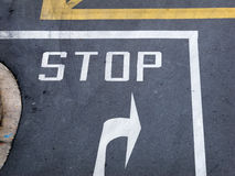 Stop sign at road junction Royalty Free Stock Image