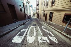 Stop sign on scenic asphalt road in residential areal of San Francisco. Stop sign on scenic asphalt road in residential areal of San Francisco Stock Photography