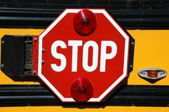 Stop sign on a school bus Royalty Free Stock Images