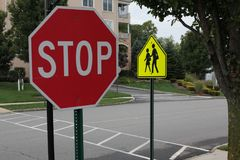 STOP SIGN at SCHOOL CROSS WALK Royalty Free Stock Images
