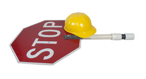 Stop Sign on a Short Pole with a Construction Hat Stock Photography