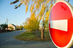 Stop sign by the side of the road stock images