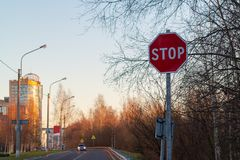 Stop sign on the side of the road at the entrance to the city royalty free stock images