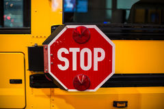 Stop sign on side on yellow School Bus Royalty Free Stock Image