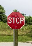 Stop  sign on the sidewalk Stock Photos