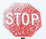 Stop sign with snow Royalty Free Stock Image