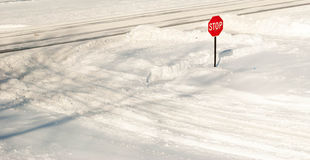 Stop sign in the snow. Royalty Free Stock Photography