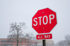 Stop sign in snowy day Stock Image