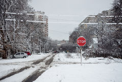 Stop sign on a snowy road. Winter cityscape Stock Photo