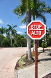 Stop Sign in Spanish and English. Traffic Sign in Spanish (Alto) and English (English Stock Photography