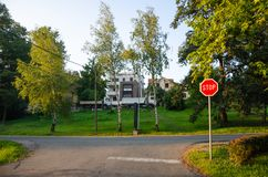 Stop sign and a street. Stop sign with empty street behind in the daytime royalty free stock images