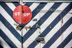 Stop sign on a striped fence Stock Image