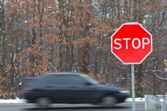 Stop sign with traffic cars Royalty Free Stock Photography