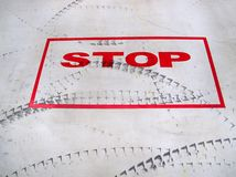 Stop sign and tyre trace. Royalty Free Stock Photo