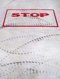 Stop sign and tyre trace. Royalty Free Stock Images