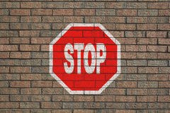 Stop sign on wall Royalty Free Stock Image