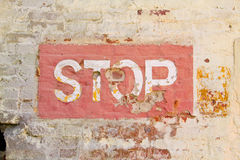 Stop sign on wall. Red stop sign on wall of bricks Stock Photo