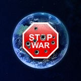 Stop sign war in the background of the globe. Royalty Free Stock Image