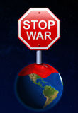 Stop sign war on planet earth. Stock Image