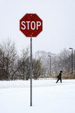 Snowstorm traffic sign. Stop sign with a winter walk during a snowstorm Royalty Free Stock Photo
