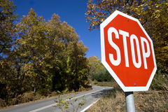 Stop sign in the woods Royalty Free Stock Photography