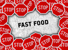 Stop sign and word fast food. Close Royalty Free Stock Images