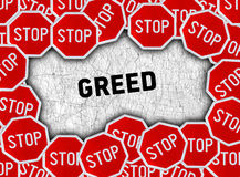 Stop sign and word greed. Close Royalty Free Stock Photography