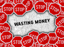 Stop sign and word wasting money Royalty Free Stock Image