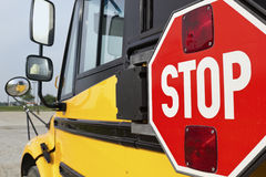 Stop sign on yellow school bus Royalty Free Stock Images