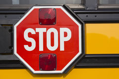 Stop sign on yellow school bus Stock Image