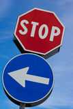 Stop signal with left arrow Stock Photo