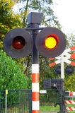 Stop signal at railway crossing Stock Photos