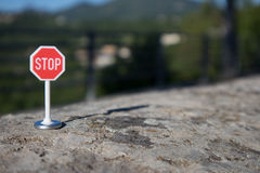 Stop signal. On a wall Royalty Free Stock Images