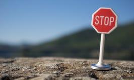 Stop signal. On a wall Stock Photos