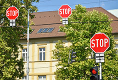 Stop signs at the road crossing. In the city Royalty Free Stock Images
