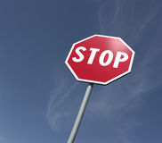 Stop sing. Red stop road sing with blue sky background stock photography