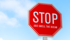 A stop and smell the ocean traffic, street sign Stock Images