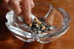 Stop smoking. Cigarette and an ashtray on the table Royalty Free Stock Photography