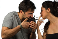 Stop smoking!. Guy trying to help his girlfriend stop smoking Stock Photography
