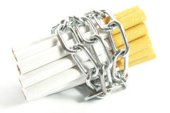 Stop smoking. Some cigarettes caged by chain Stock Images