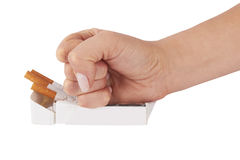 Stop smoking. Fist with crushed pack of cigarettes Stock Image