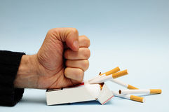 Stop smoking. Man hand crushing a packet of cigarettes, stop smoking concept Stock Photography