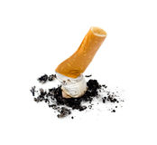Cigarette smoking. Cigarette butt with black ashes on a isolated white background. Close up Royalty Free Stock Photography