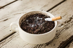 Stop smoking. Cigarette butt in the cigarette trash bow Royalty Free Stock Image