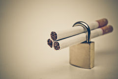 Stop smoking cigarette. Cigarettes in a security lock - stop smoking concepts Royalty Free Stock Photography