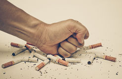 Stop smoking cigarette. Male hand destroying cigarettes - stop smoking concept Stock Photo
