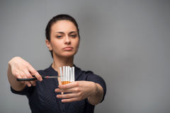 Stop smoking concept. Young woman cut cigarettes Stock Photography