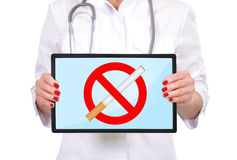Stop smoking. Hand  doctor with stop smoking on touch pad Stock Photo
