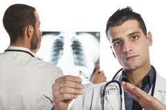 Stop smoking. Male doctor looking at the x-ray and advised to stop smoking Stock Photography