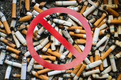 Stop smoking and many dirty cigarettes butts Royalty Free Stock Photography